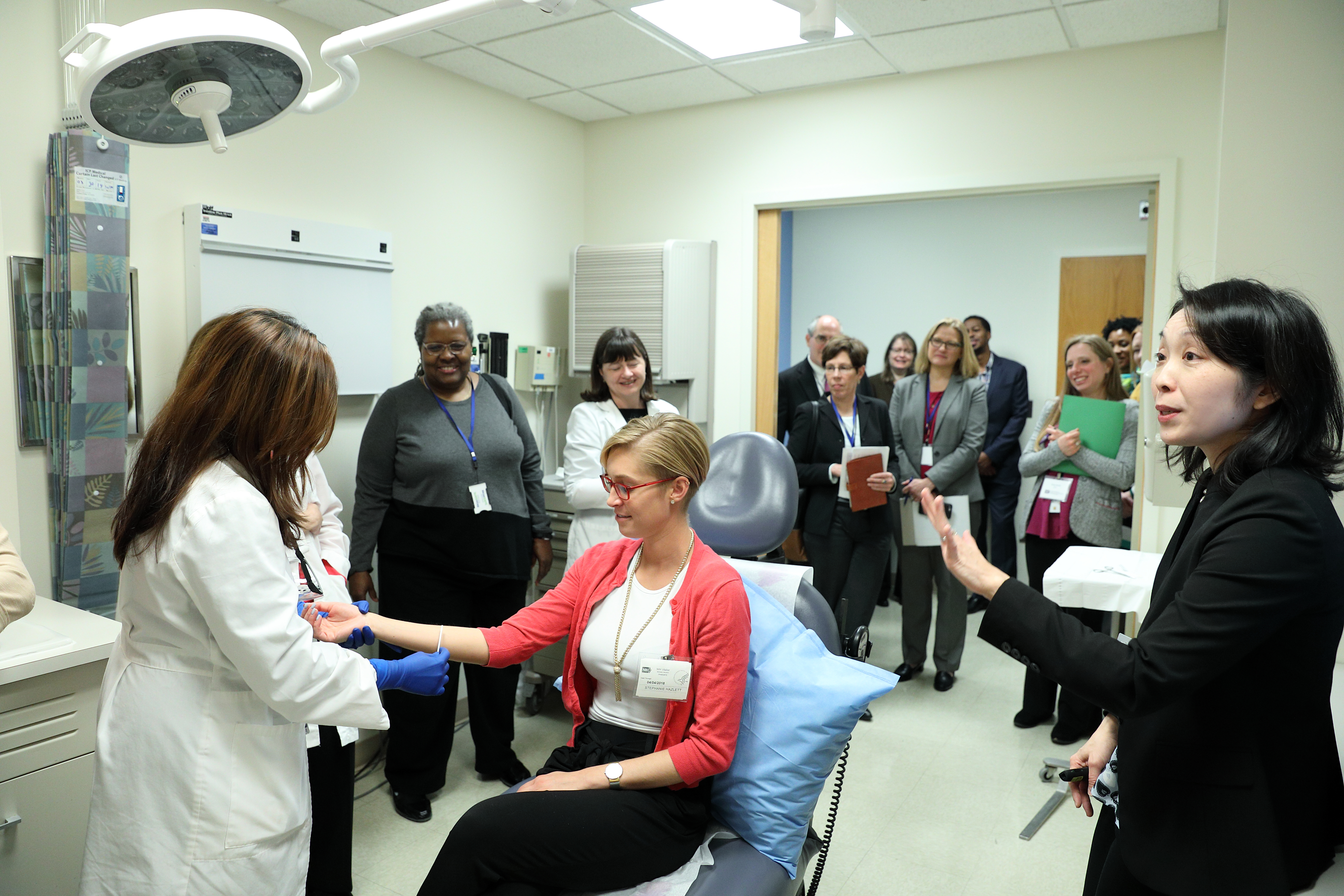 Research nurse performing mock experiment on patient