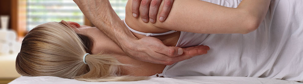 Woman being treated by a health care professional for back pain