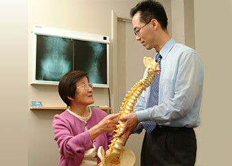 Physician and patient talking about bones