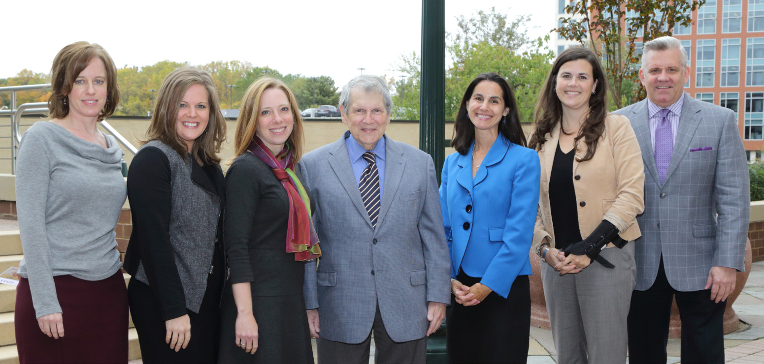 NIAMS staff and Coalition co-chairs gather around NIAMS director Dr. Stephen Katz (c).