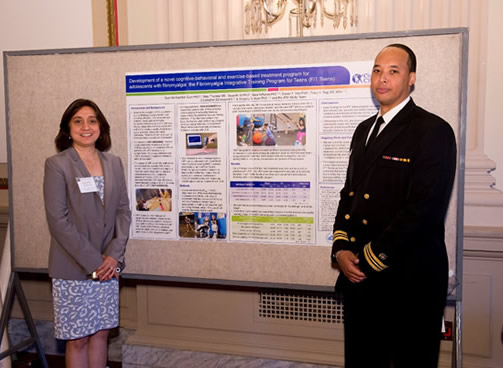 Photo of Drs. Kashikar-Zuck and Phil Tonkins at the OBSSR exhibition.