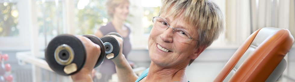 Older woman lifting weights