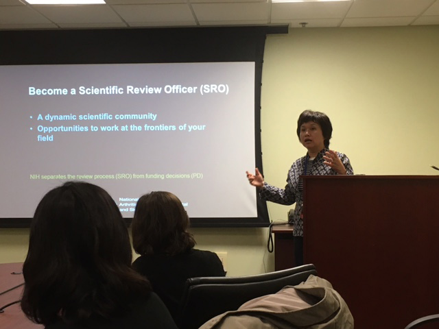 Dr. Helen Lin talks to NIAMS trainees about a career as a scientific review officer.