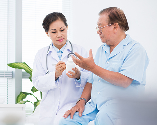 Doctor explaining medication to patient.