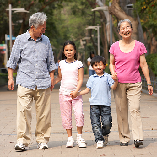 Grandparents walking with their grandchildren.