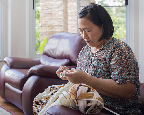 A woman weaving.