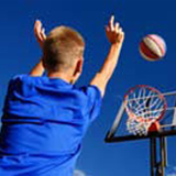 Boy shooting a basketball