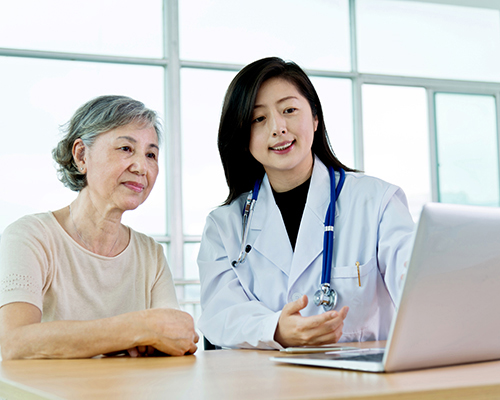 A doctor speaking with a patient.