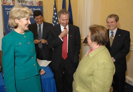 Senator Kay Bailey Hutchison (R-TX), NIH Director Dr. Elias A. Zerhouni,NASA Administrator Dr. Michael D. Griffin, Senator Barbara Mikulski (D-MD), and  Director Dr. Stephen I. Katz share a laugh before the September 12, 2007, signing ceremony.