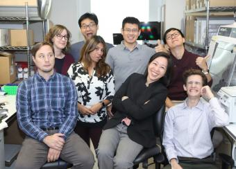 The Kong lab group making funny faces.