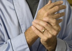Older man holding wrist