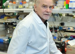 Photo of Dr. John O'Shea in the lab.
