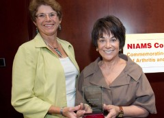 Arthritis patient Dr. Janet Stearns Wyatt (l) presents the NIAMS Coalition's Congressional Champion Award to Rep. Anna Eshoo (D-CA).